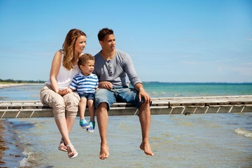 Small Family of Three by the Beach