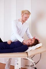 Practitioner Manipulating Patient's Neck