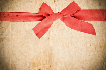 Empty vintage paper with red bow