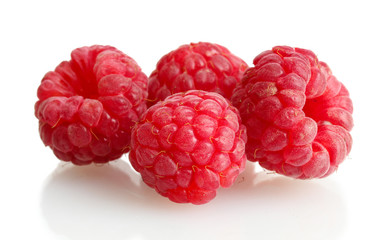 ripe raspberries isolated on white