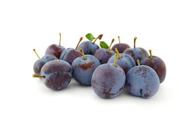 Plums on the white background