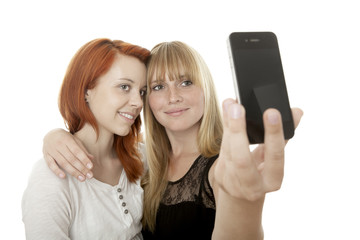 young beautiful red and blond haired girls doing a self portrait