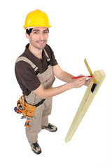 Tradesman using a try square to measure an angle