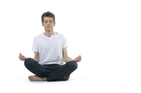 Yoga male doing yoga on white