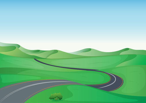 a green landscape and a road