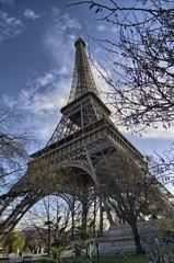 The Eiffel Tower in Paris shot against a blue winter sky