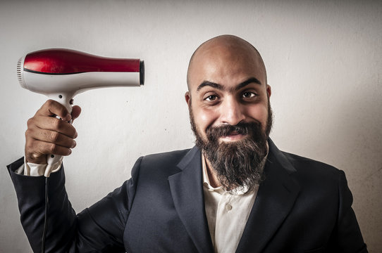 man bearded and jacket with hairdraier and funny expressions