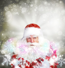 Christmas theme: Santa Claus blowing snowflakes from his arms. D