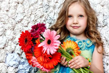 portrait little lovely girl in a pink dress