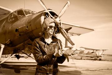 Portrait of beautiful female pilot