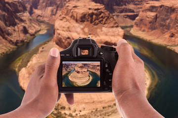 Photographer taking pictures of the Horseshoe bend