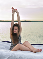 The girl woke up in a bed on water
