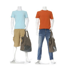 full length two male mannequin dressed with bag