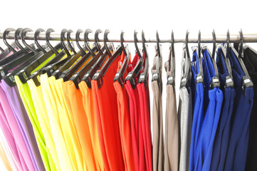 colorful female trousers on hangers