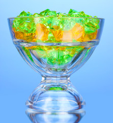 A glass with colorful decorative stones