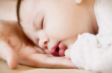 newborn on mother's hands
