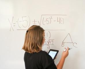Preteen student working math problem