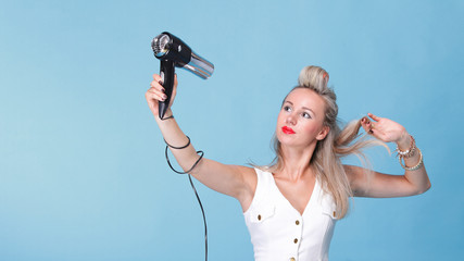 pin up girl retro style portrait woman drying hair