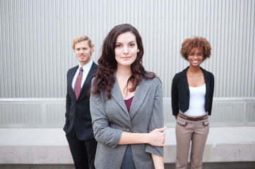 attractive young business group standing together at office