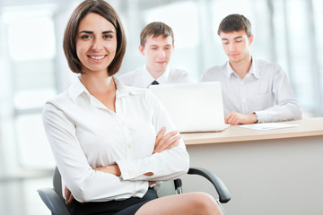 Beautiful young business woman with colleagues