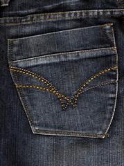 Close up of fancy washed jeans pocket