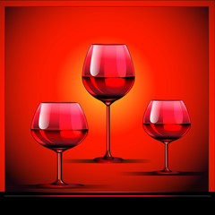 three goblets with wine on bright background