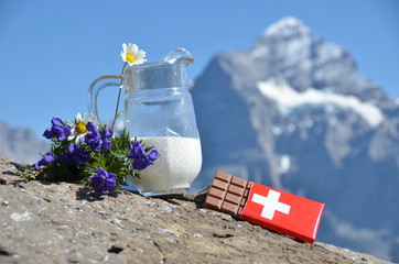 Wall Mural - Swiss chocolate, jug of milk and Apline flowers. Switzerland