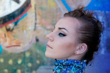 close-up portrait of creative woman with blue make up