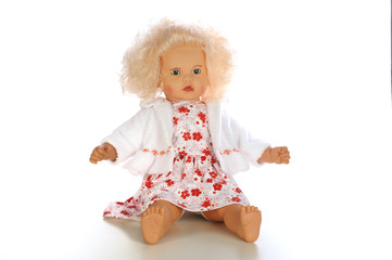 Belonde baby doll sitting isolated white bacground