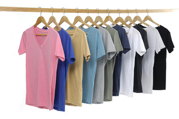man clothes of different colors on wooden hangers