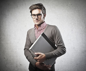 Man Holding a Laptop Computer