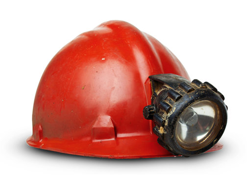 vintage miners helmet with lamp on a white background
