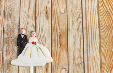 wedding bride and groom couple doll on wood background