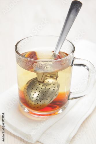 Making tea with tea infuser,
