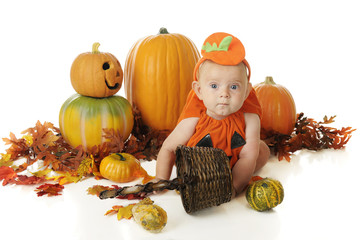 Baby Surrounded by Pumpkins