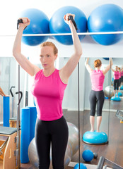 Bosu ball for fitness woman in aerobics gym