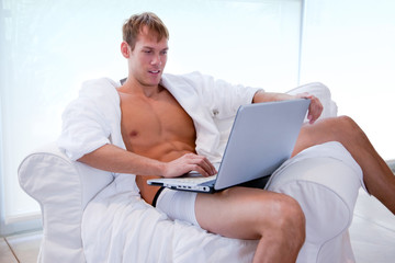 Young Man  Shopping By Laptop