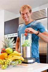 Young Man  makeing a Smoothie
