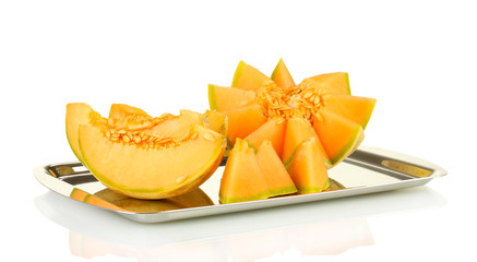 Cut melon on metal tray isolated on white