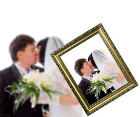 Closeup picture frame making the photo of kissing just married c