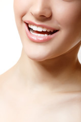 Beautifuk female smile with healthy perfect white teeth