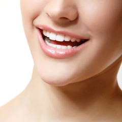 Smile of beautiful woman with great healthy white teeth.