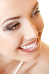 beauty portrait of young woman bride with beautiful makeup