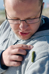 Guy pointing at caterpillar