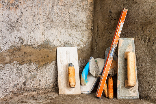 Dirty masonry tools on an unfinished construction
