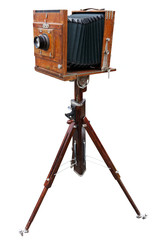 Wooden classic camera on tripod. Clipping path.