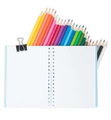 the blank notebook and colors pencil isolated on white