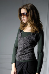 young blonde girl in fashion dress wearing sunglasses