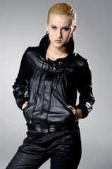High fashion model in fashion dress posing on gray