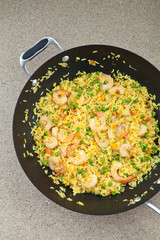 Shrimp and rice dish with red pepper and peas